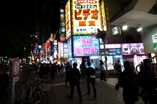 "One of Shibuya's largest ""free information centers"" blends into the background on Dogenzaka."