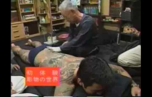 Tattoo artist Choshiro Nakano works on a gang member