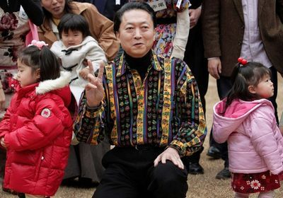 """With children at a session of """"Real Hato Cafe"""" (February 2010)"""