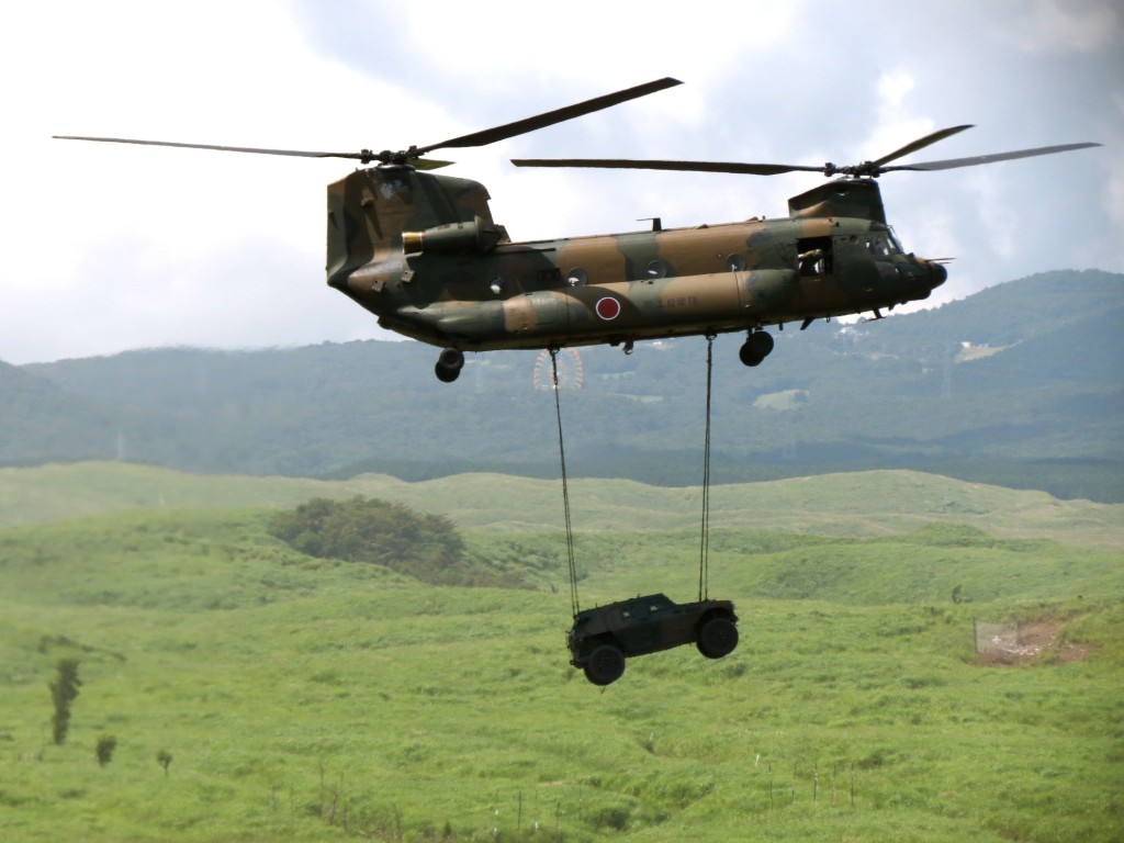 Transporting vehicle by helicopter XXX
