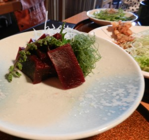 Whale bacon, whale sashimi (raw whale) and whale tempura at Japanese restaurant