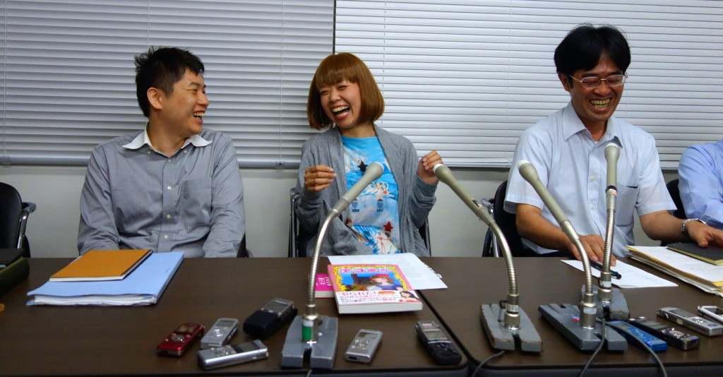 "Rokudenashiko shares a moment of levity with her lawyers after being asked why ""vagina"" (manko) is such a taboo word on Japanese television. The absurdity of Japanese obscenity laws is funny---unless you get put in jail for them."